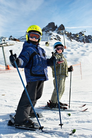 Children on the snowy ski slopes on resort