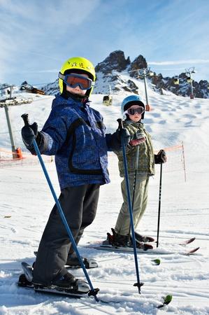 ski slopes: Children on the snowy ski slopes on resort