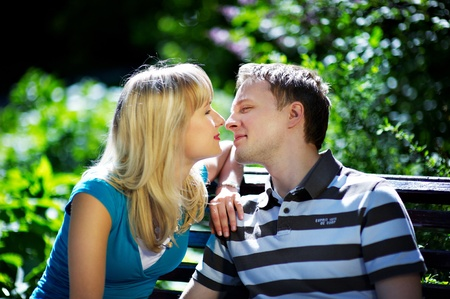 Lovers man and woman in sun garden photo