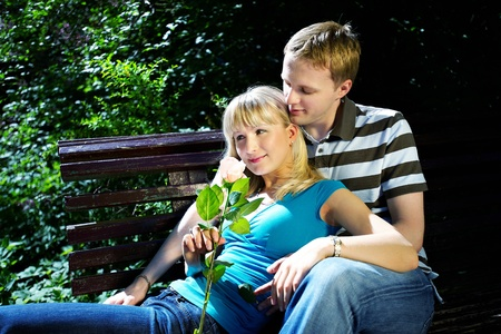 Lovers man and woman in sun garden Stock Photo - 10697917