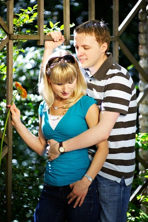 Lovers man and woman with gerbera flower in romantic date in park Stock Photo - 10697890