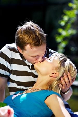 Romantic kiss happy couple in spring park photo