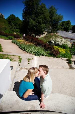 Romantic kiss happy couple in park photo