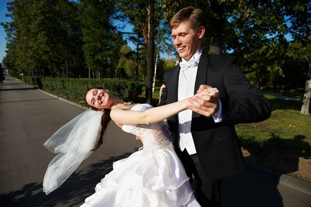 Wedding dance bride and groom in a park photo