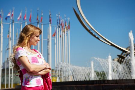 Young woman on square of Moscow city on background of sky Stock Photo - 10811407