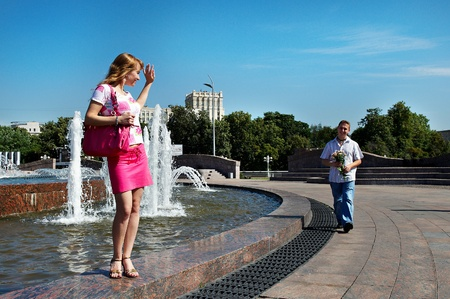 Dating young men and women lovers in city park  photo
