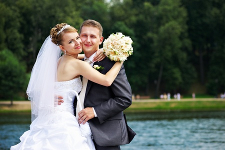 Romantic couples bride and groom at wedding walk photo