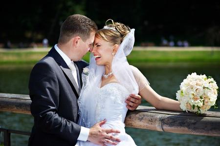 Happy couple bride and groom at a wedding walk