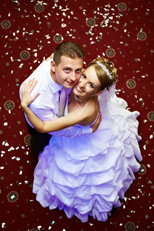 Happy bride and groom in wedding day in dance floor photo