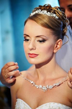 Wedding necklaces Brides in hands of groom  Stock Photo