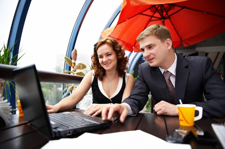 Joyful man and woman on business lunch in cafe Stock Photo - 11559173