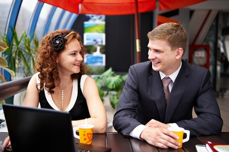 negotiation business: Joyful man and woman on business lunch in cafe