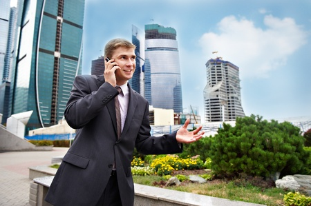 Business positive talks on the phone on the street Stock Photo - 11559164