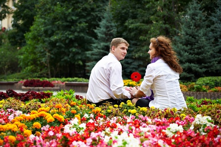 Romantic date young people in the flower park