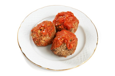 Meatballs in tomato sauce isolated on white background