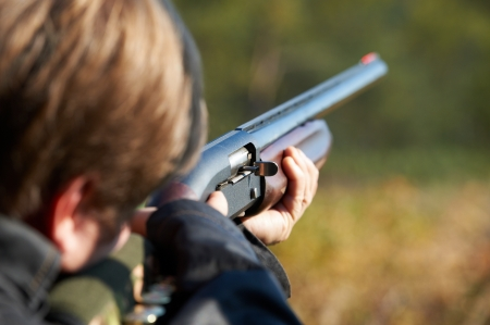 Shooter takes aim for a shot from rifle