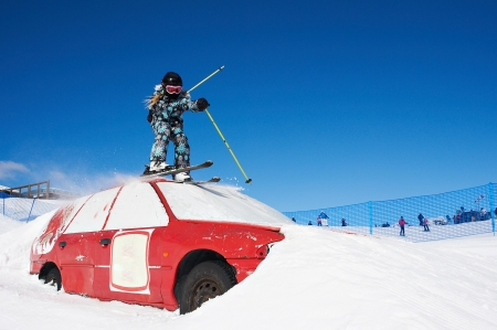 Extreme skiing in the ski park with red car Stock Photo - 13728496