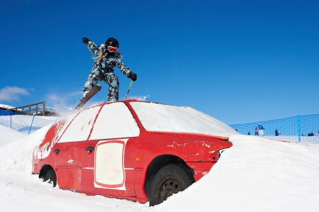 Extreme skiing in the ski park with red car Stock Photo - 13728442