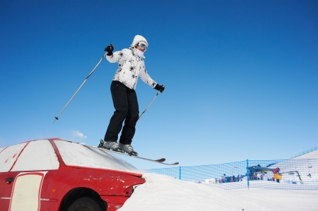 Woman riding in skiing on sunny day photo