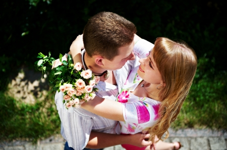 Embrace romantic lovers on summer landscape photo