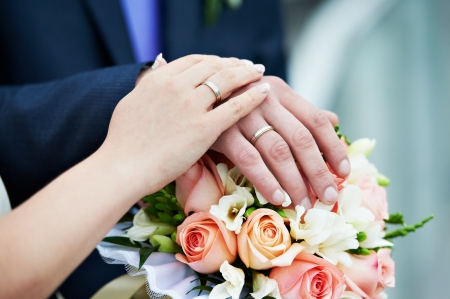 Hands with wedding gold rings happy newlyweds photo