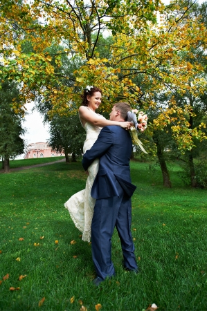Romantic bride and groom embrace at wedding walk photo