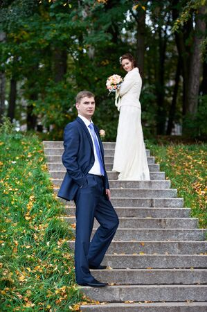 Romantic bride and groom at wedding walk photo