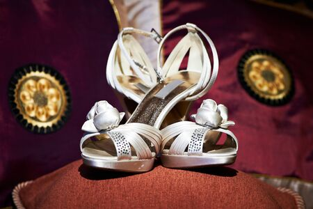 Wedding shoes for brides burgundy background with patterns photo