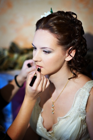 Make up the bride in wedding day
