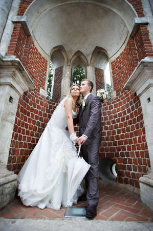 Happy bride and groom in a beautiful arch at the old bridge Stock Photo - 13834775
