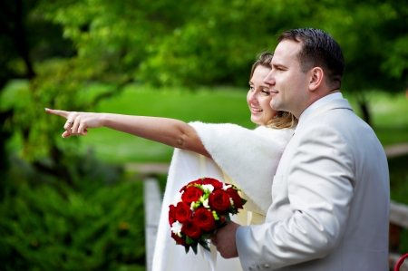 Happy bride and groom on wedding walk in park Stock Photo - 13842996