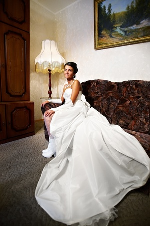 Beautiful Bride in long wedding dress in a classical inter at home Stock Photo - 13871424