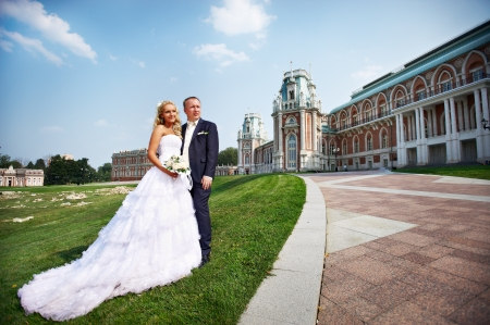 Happy bride and groom about luxury palace in wedding day