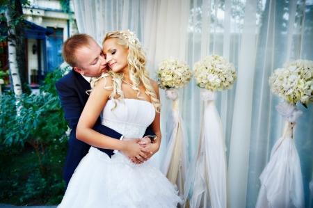 bridal makeup: Happy bride and groom in wedding gazebo
