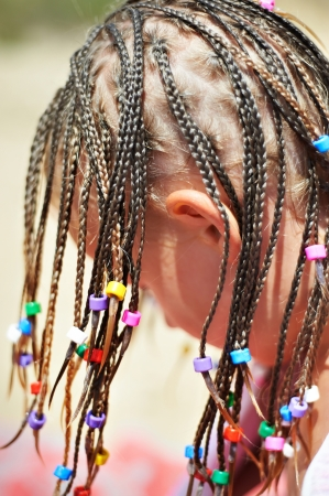 Little girl with african pigtails photo