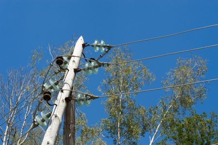 power lines: High voltage power lines against the blue sky Stock Photo
