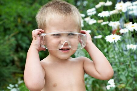 Portrait of a child in the electrical safety protection glasses photo