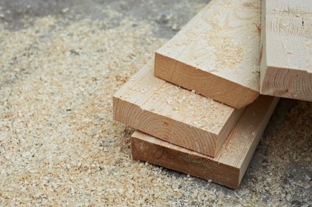 Fresh wooden studs and sawdust Stock Photo
