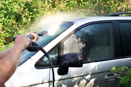 pressured: Washing car with pressured water outdoors Stock Photo