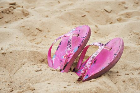 Beach flip flops in the sand photo