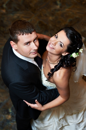 Romantic embrace the happy bride and groom in wedding dance   photo