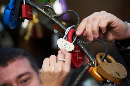 marital: lock lovers as a symbol of marital happiness in hands of the newlyweds