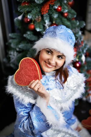 Happy woman with Christmas costume Snow-Maiden show gift photo