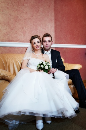Happy bride and groom in wedding day in marriage palace photo