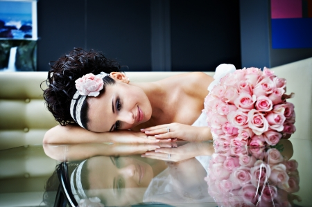 Romantic bride with a wedding bouquet on luxury modern interior