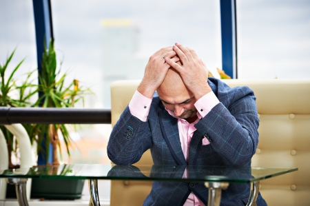 Man put his head in despair on table Stock Photo - 17450401
