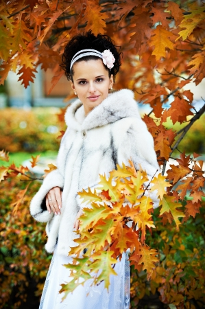 Elegant bride in autumn park on wedding walk Stock Photo - 17450397