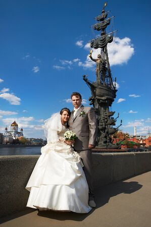 peter the great: Bride and groom on the background of the monument to Peter the Great in Moscow