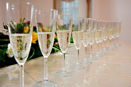 Champagne glasses on festive table Stock Photo