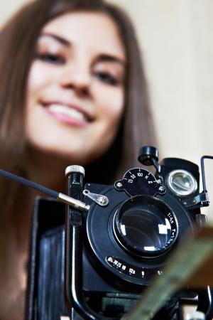 rarity: Young girl with big old camera rarity